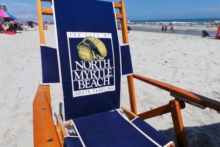 Beach chair on a sandy white beach
