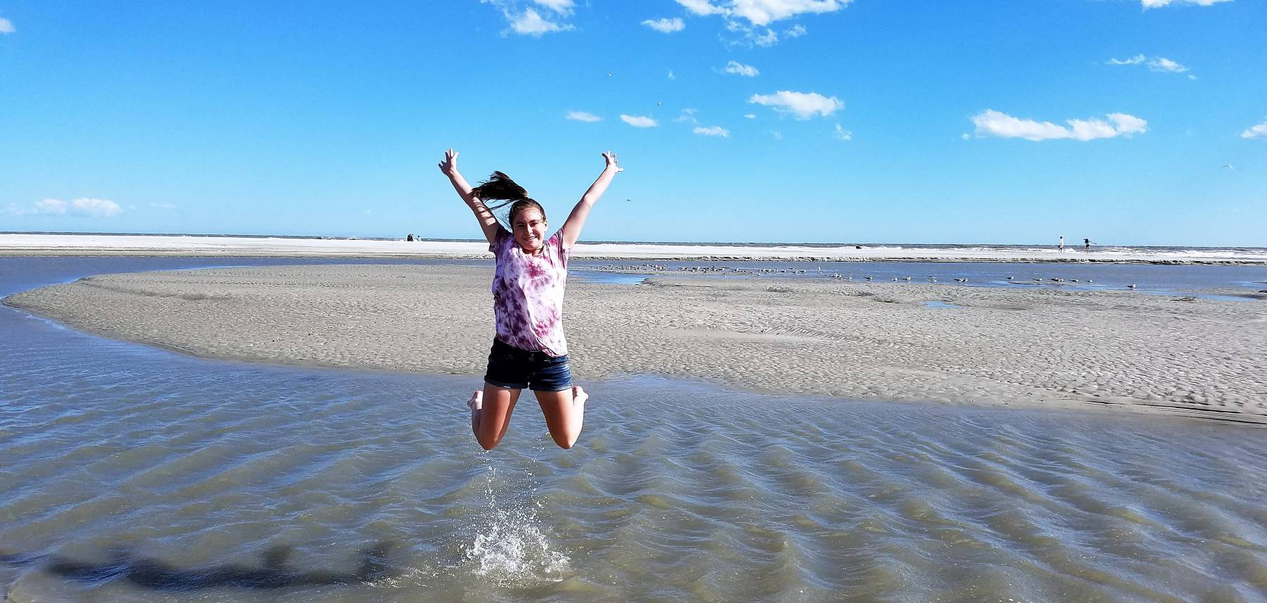 Girl jumping in excitement on Myrtle Beach